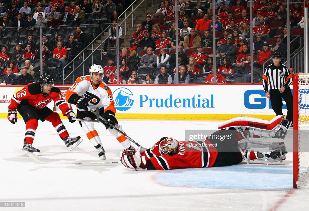 Keith Kinkaid #1 of the New Jersey Devils reaches out to stop Valtteri Filppula #51 of the Philadelphia Flyers during the third period at the Prudential Center on April 4, 2017 in Newark, New Jersey. The Devils defeated the Flyers 1-0 in overtime.
