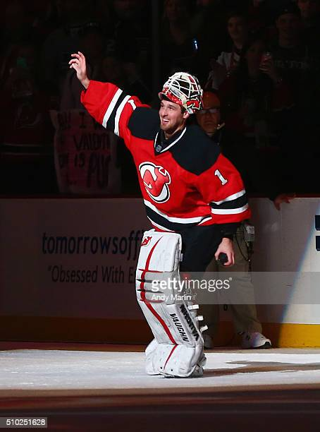 Keith Kinkaid of the New Jersey Devils salutes the fans after being named the first star of the game after recording his first NHL shutout after...