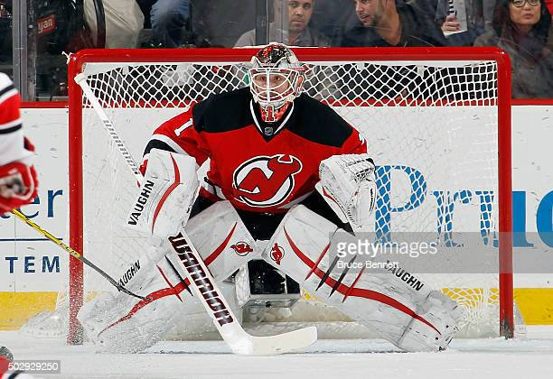 Keith Kinkaid of the New Jersey Devils skates against the Carolina Hurricanes at the Prudential Center on December 29 2015 in Newark New Jersey The...