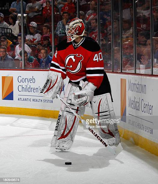 Keith Kinkaid of the New Jersey Devils skates against the New York Rangers during a preseason game at the Prudential Center on September 16 2013 in...