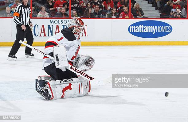 Keith Kinkaid of the New Jersey Devils tends net against the Ottawa Senators at Canadian Tire Centre on December 17 2016 in Ottawa Ontario Canada