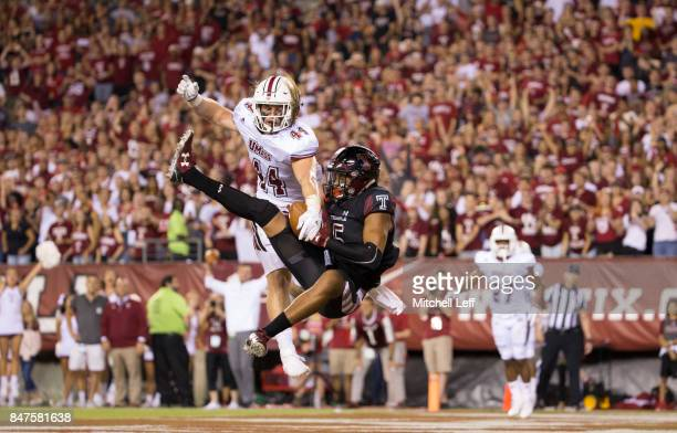 Keith Kirkwood of the Temple Owls catches a touchdown pass against Bryton Barr of the Massachusetts Minutemen in the second quarter at Lincoln...