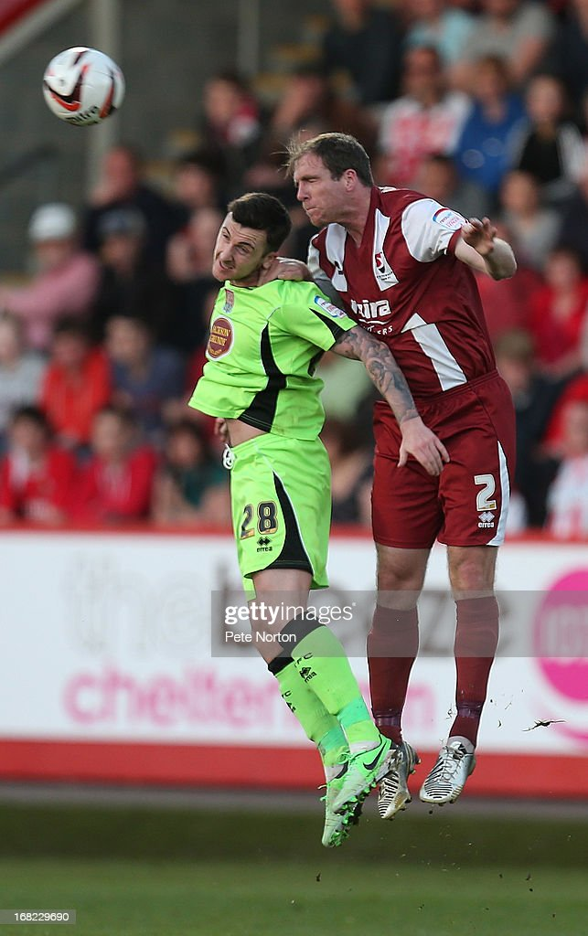 Keith Lowe (R) of Cheltenham Town contests the ball with Roy O'Donovan of Northampton Town during the npower League Two Play Off Semi Final Second Leg between Cheltenham Town and Northampton Town at Abbey Business Stadium on May 5, 2013 in Cheltenham, England.