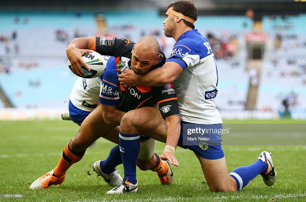 Keith Lulia of the Tigers scores his third try during the round 19 NRL match between the Wests Tigers and the Canterbury Bulldogs at ANZ Stadium on July 20, 2014 in Sydney, Australia.