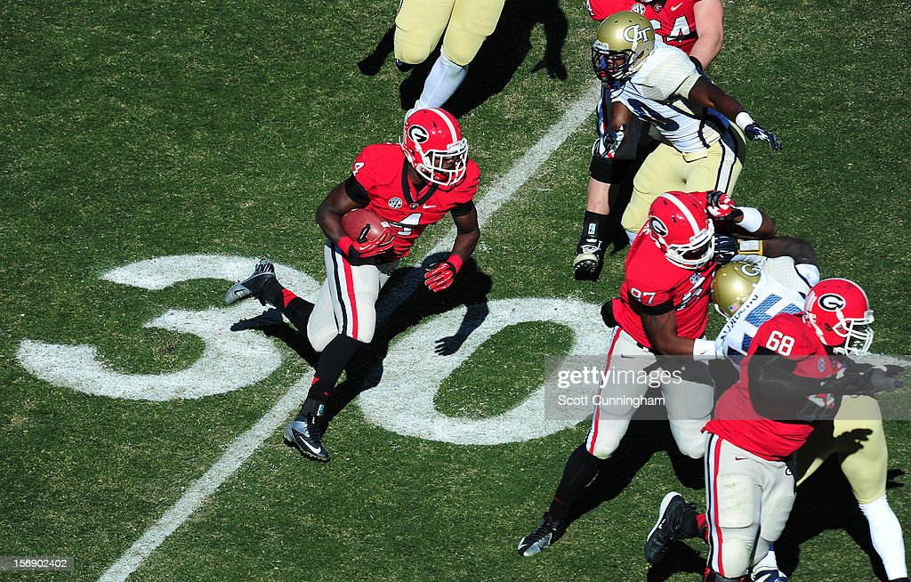 Keith Marshall #4 of the Georgia Bulldogs carries the ball against the Georgia Tech Yellow Jackets at Sanford Stadium on November 24, 2012 in Athens, Georgia.