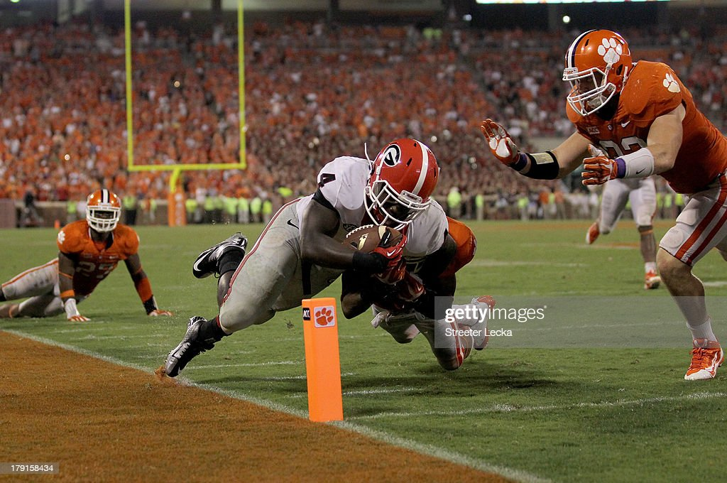 Keith Marshall #4 of the Georgia Bulldogs dives for a touchdown against the Clemson Tigers during their game at Memorial Stadium on August 31, 2013 in Clemson, South Carolina.