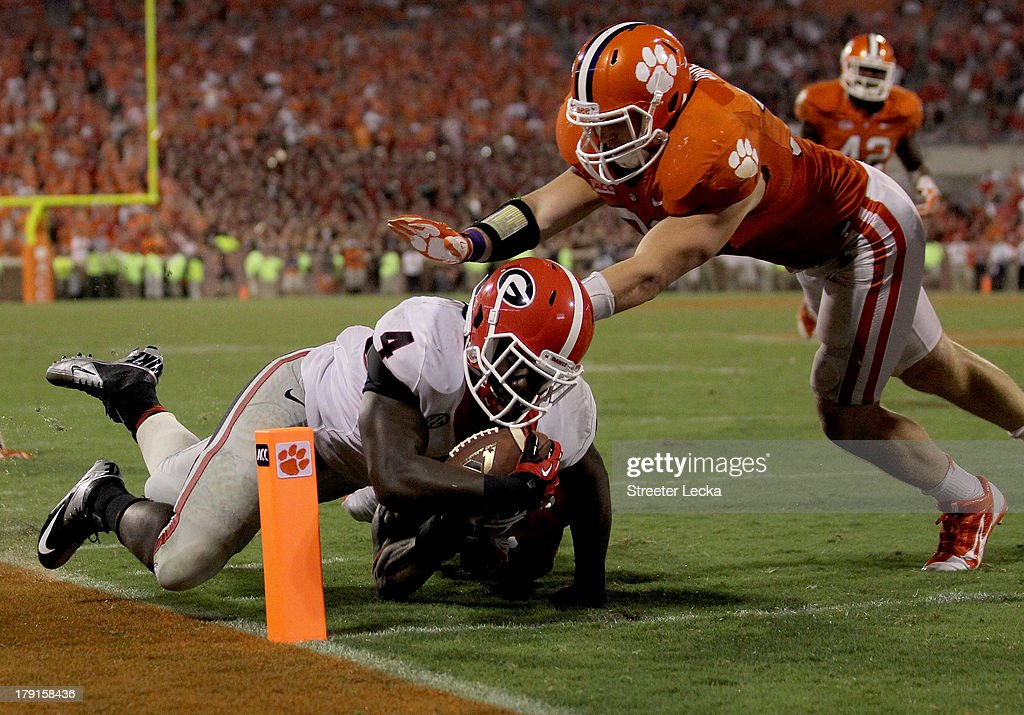 Keith Marshall #4 of the Georgia Bulldogs dives for the endzone against the Clemson Tigers during their game at Memorial Stadium on August 31, 2013 in Clemson, South Carolina.