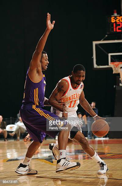 Keith McLeod of the Albuquerque Thunderbirds moves the ball past Charlie Parker of the Los Angeles DFenders during the NBA DLeague game on November...