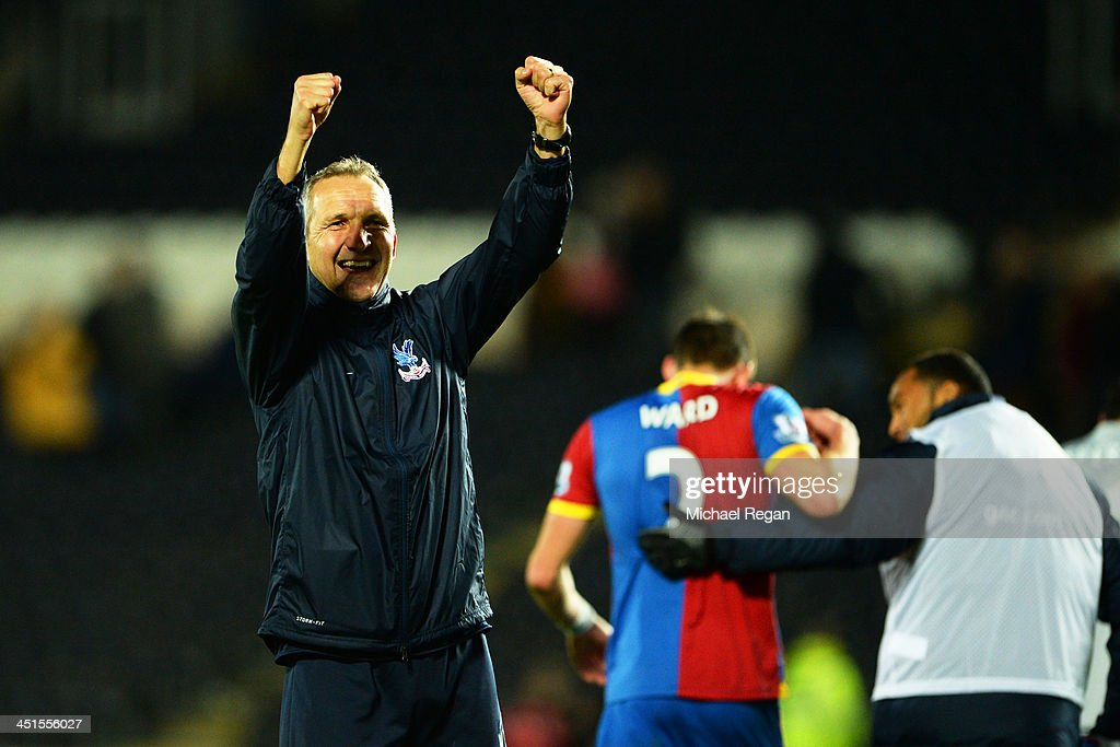 Keith Millen, caretaker manager of Crystal Palace celebrates victory after the Barclays Premier League match between Hull City and Crystal Palace at KC Stadium on November 23, 2013 in Hull, England.