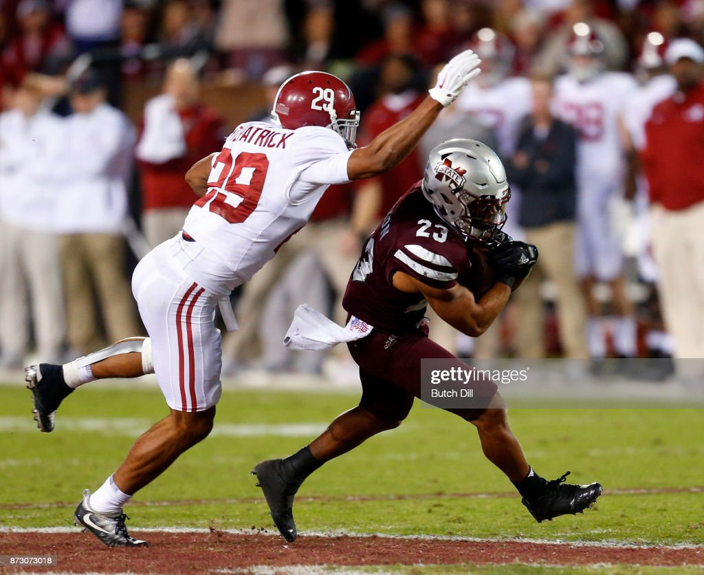 Keith Mixon #23 of the Mississippi State Bulldogs catches a pass as Minkah Fitzpatrick #29 of the Alabama Crimson Tide defends during the second half of an NCAA football game at Davis Wade Stadium on November 11, 2017 in Starkville, Mississippi.