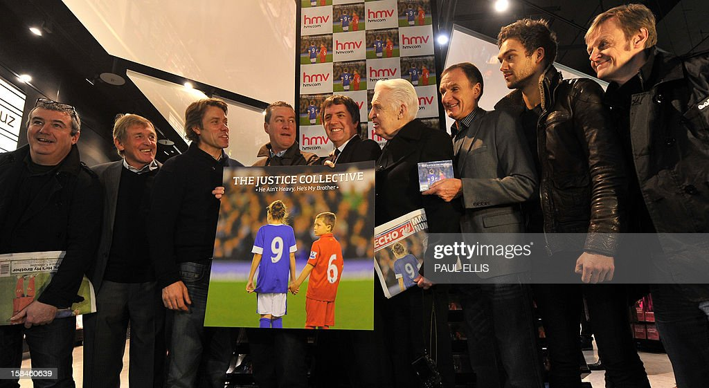 Keith Mullen of The Farm, former Liverpool football manager Kenny Dalglish, comedian John Bishop, Peter Hooten of The Farm, Steve Rotherham MP, former Liverpool player Phil Thompson, photographer Mike McCartney, Andy Brown from Lawson and Carl Hunter from The Farm pose for the media at the launch of the charity recording 'He Ain't Heavy, He's My Brother' at HMV in Liverpool, north-west England on December 17, 2012. The recording has been made to support the families of Liverpool football club supporters who died during the Hillsborough Disaster in 1989. Proceeds will go towards legal costs in the families' continued fight to quash the accidental death inquest verdicts. An application to overturn the verdict was made by Attorney General Dominic Grieve and is due before the High Court in London on December 19. AFP PHOTO/PAUL ELLIS