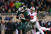Keith Mumphery of the Michigan State Spartans catches a pass defended by Gareon Conley of the Ohio State Buckeyes at Spartan Stadium on November 8...