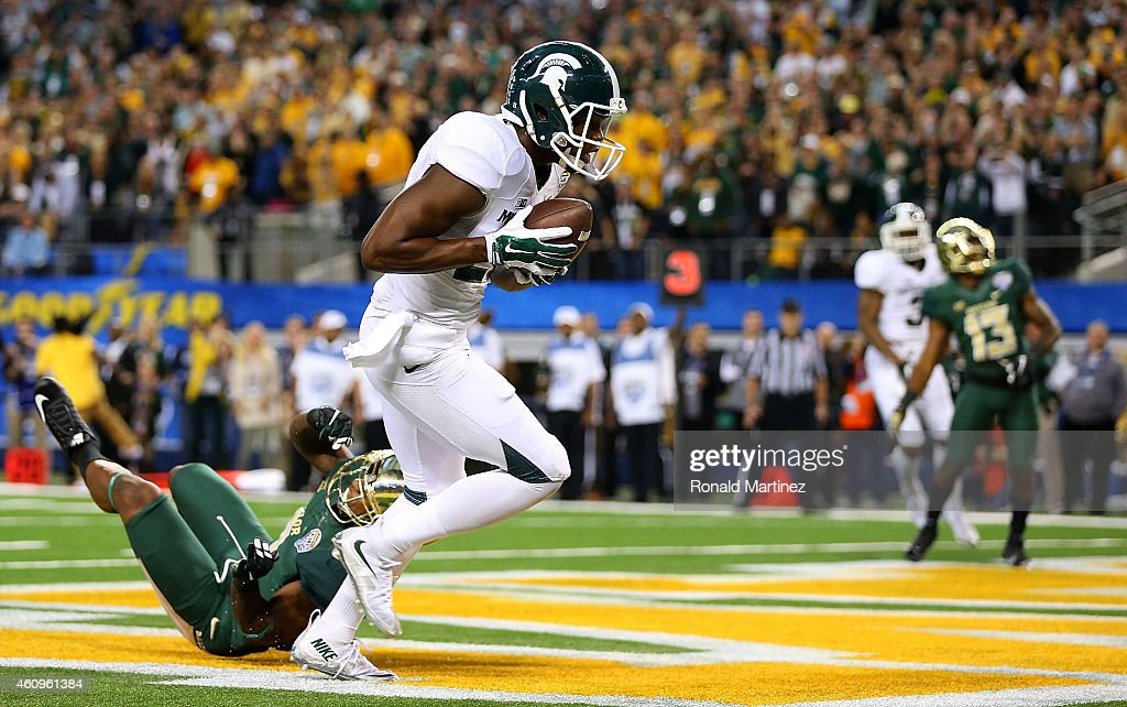 Keith Mumphery of the Michigan State Spartans makes the catch for a game winning touchdown as Ryan Reid of the Baylor Bears defends during the second...