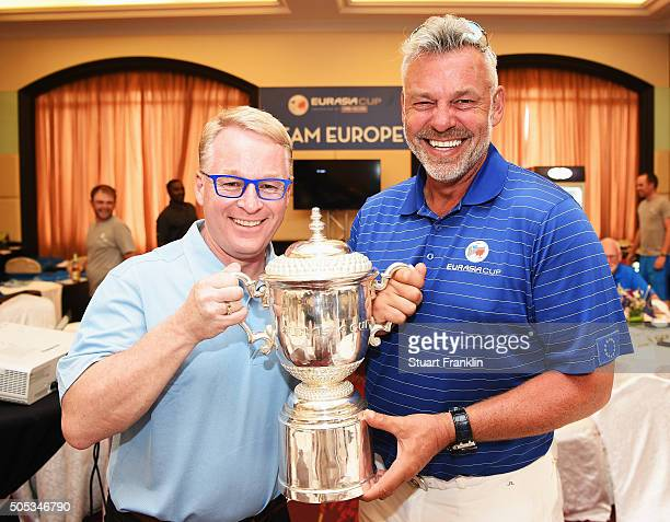 Keith Pelley CEO of the European tour holds the winners trophy with Darren Clarke Captain of team Europe after the final day's singles matches at the...