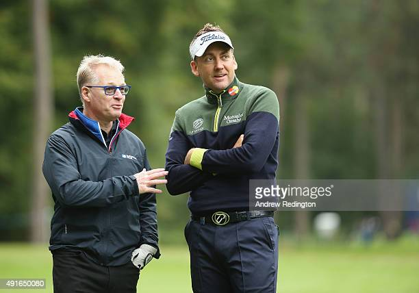 Keith Pelley Chief Executive of The European Tour and Ian Poulter of England chat together during the Pro Am event prior to the start of the British...