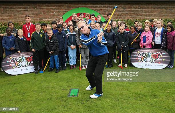 Keith Pelley Chief Executive of The European Tour plays a shot as he watched by members of the Golf Foundation's Street Golf inititaive during the...