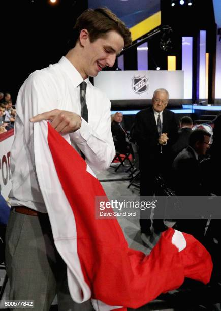 Keith Petruzzelli puts on his jersey after being selected 88th overall by the Detroit Red Wings during the 2017 NHL Draft at United Center on June 24...