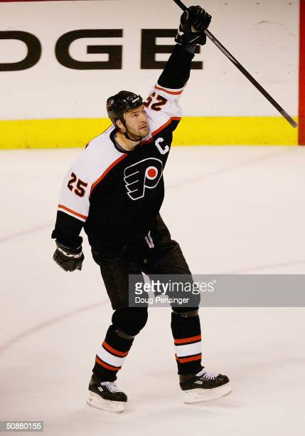 Keith Primeau of the Philadelphia Flyers celebrates after scoring the game tying goal in the third period against the Tampa Bay Lightning in Game six...