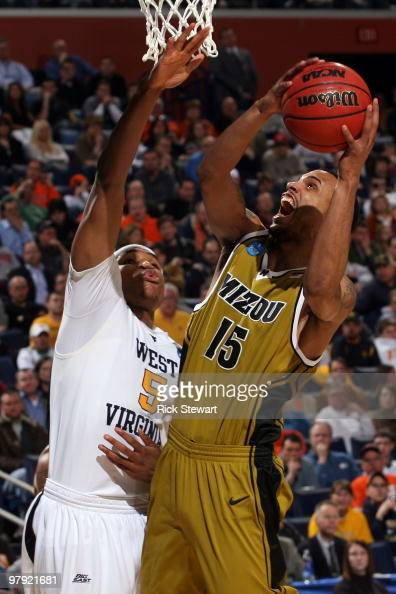 Keith Ramsey of the Missouri Tigers goes to the hoop against Kevin Jones of the West Virginia Mountaineers during the second round of the 2010 NCAA...
