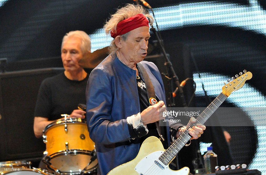 Keith Richards and Charlie Watts of The Rolling Stones perform live on stage, during their 50th anniversary tour at O2 Arena on November 29, 2012 in London, England.