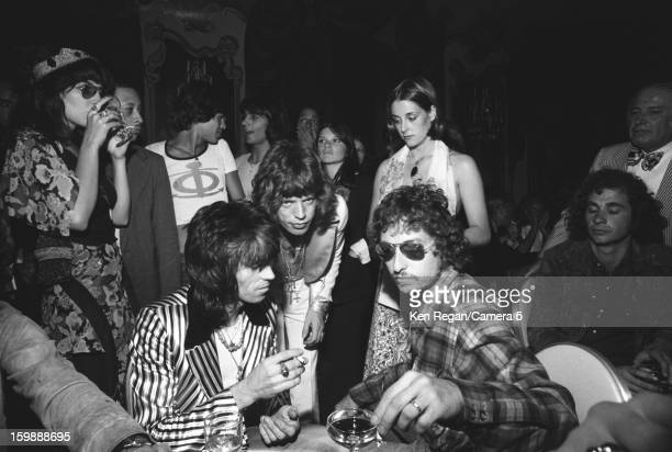 Keith Richards and Mick Jagger of The Rolling Stones with singer Bob Dylan are photographed at Mick Jagger's 30th birthday party in 1972 in New York...
