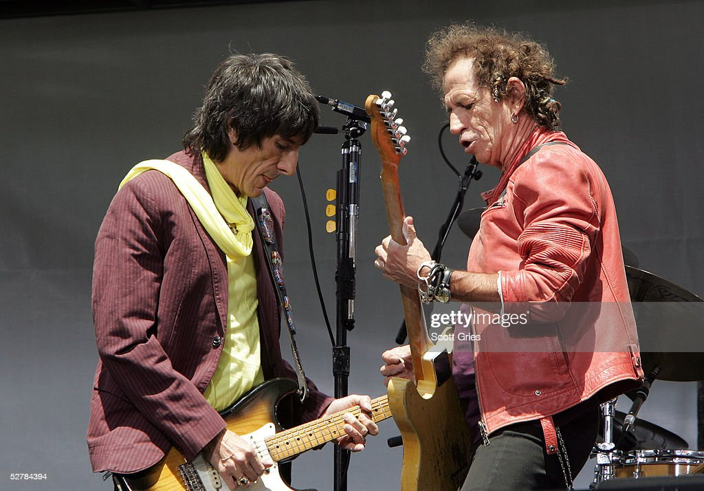 Keith Richards (R) and Ron Wood of The Rolling Stones perform onstage during a press conference to announce a world tour at the Julliard Music School May 10, 2005 in New York City.