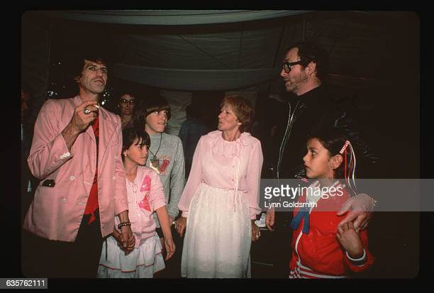 Keith Richards guitarist for the Rolling Stones holds his daughter Angela's hand Next to them from left are Richards' son and mother Marlon and Doris...