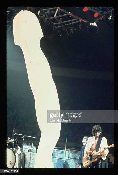 Keith Richards guitarist for the Rolling Stones shares the stage with singer Mick Jagger and a giant stage prop an inflatable white penis