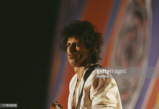Keith Richards guitarist with British rock band The Rolling Stones on stage during a live concert performance by the band at the Carrier Dome in...