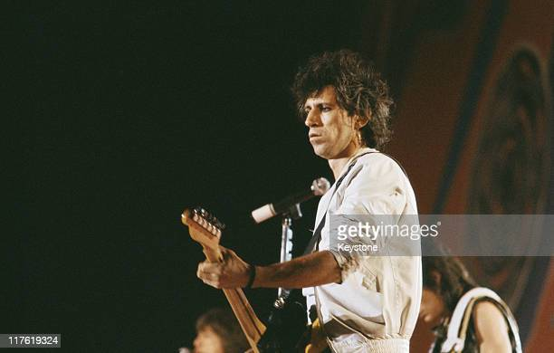 Keith Richards guitarist with British rock band The Rolling Stones playing the guitar on stage during a live concert performance by the band at the...