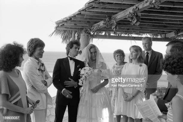 Keith Richards of the Rolling Stones and Patti Hansen are photographed with Mick Jagger on their December 18 1983 wedding in Cabo San Lucas Mexico...