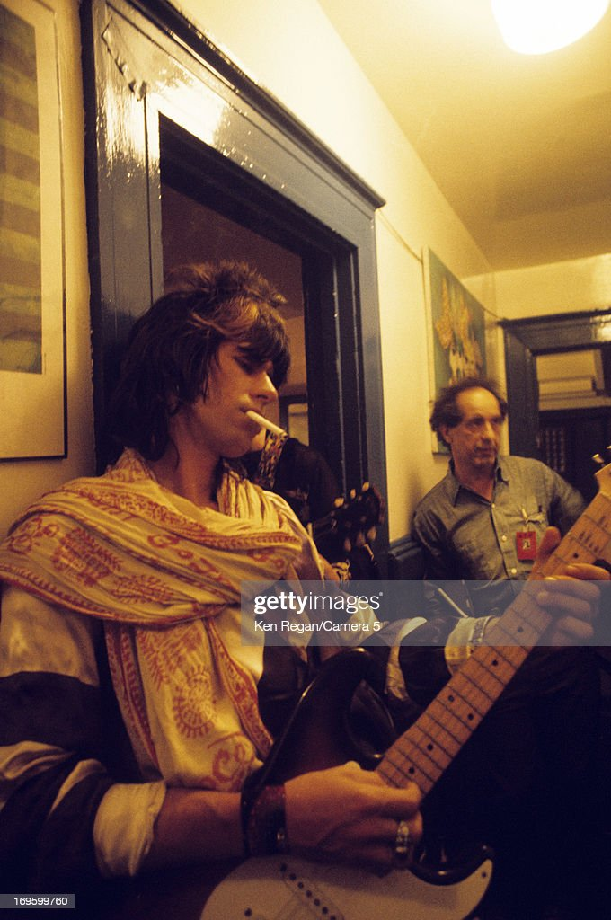 Keith Richards of, The Rolling Stones and Robert Frank are photographed backstage in 1972 in Long Beach, California.