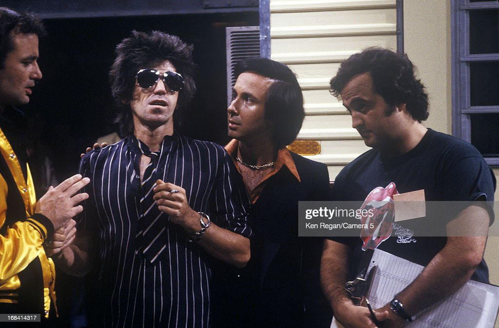 Keith Richards of the Rolling Stones, Bill Murray and John Belushi are photographed on the set of Saturday Night Live on October 7, 1978 in New York City.