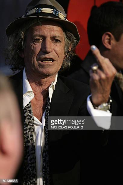 Keith Richards of the Rolling Stones gives the middle finger to photographers at the premiere of the new Martin Scorsese movie about the Rolling...
