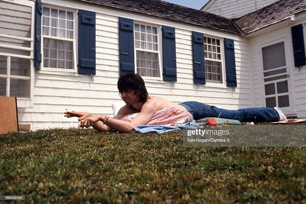 Keith Richards of the Rolling Stones is photographed at artist Andy Warhol's home in 1975 in Montauk, New York.