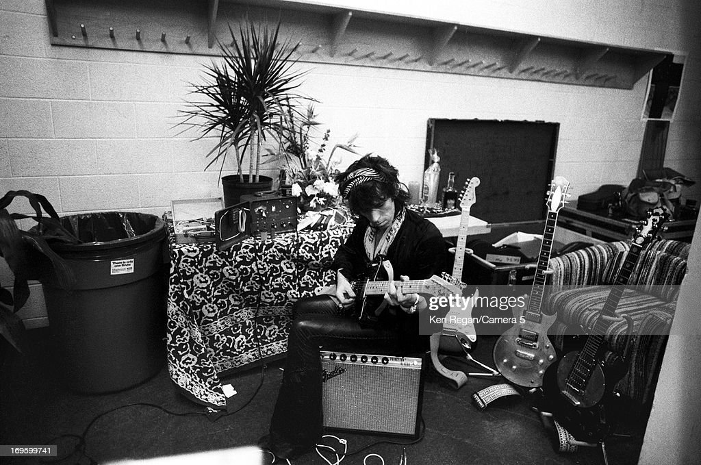 Keith Richards of the Rolling Stones is photographed backstage in June 1975 in Boston, Massachusetts.