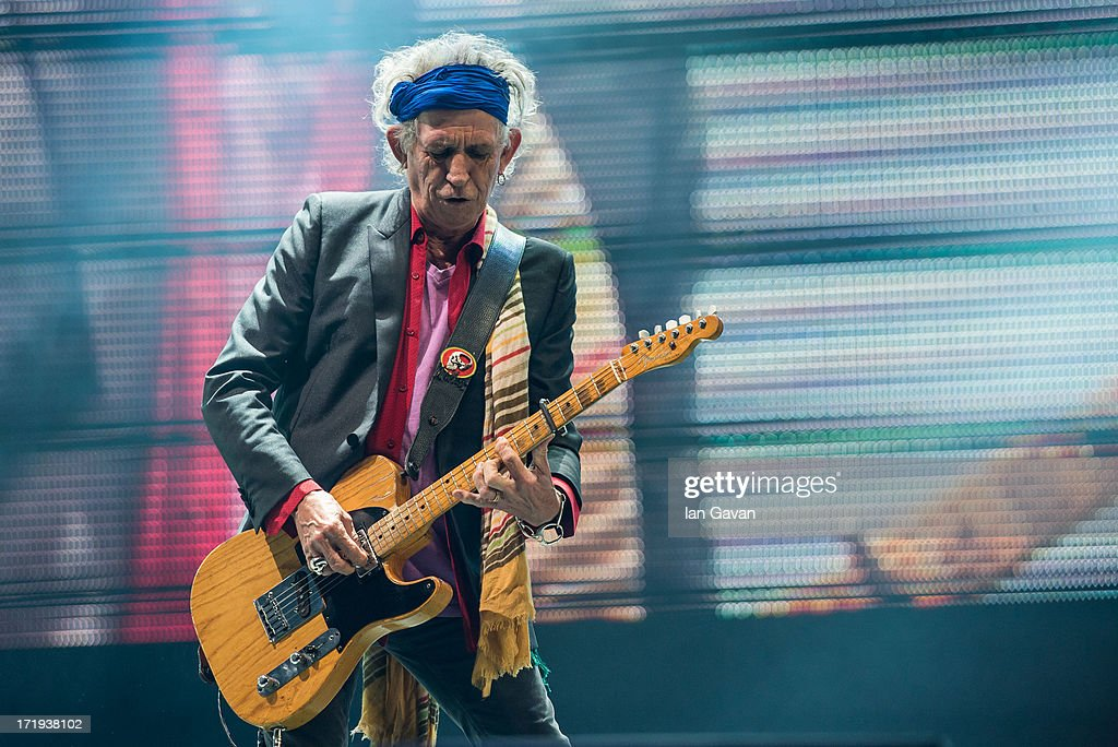 Keith Richards of The Rolling Stones perform on the Pyramid Stage during day 3 of the 2013 Glastonbury Festival at Worthy Farm on June 29, 2013 in Glastonbury, England.
