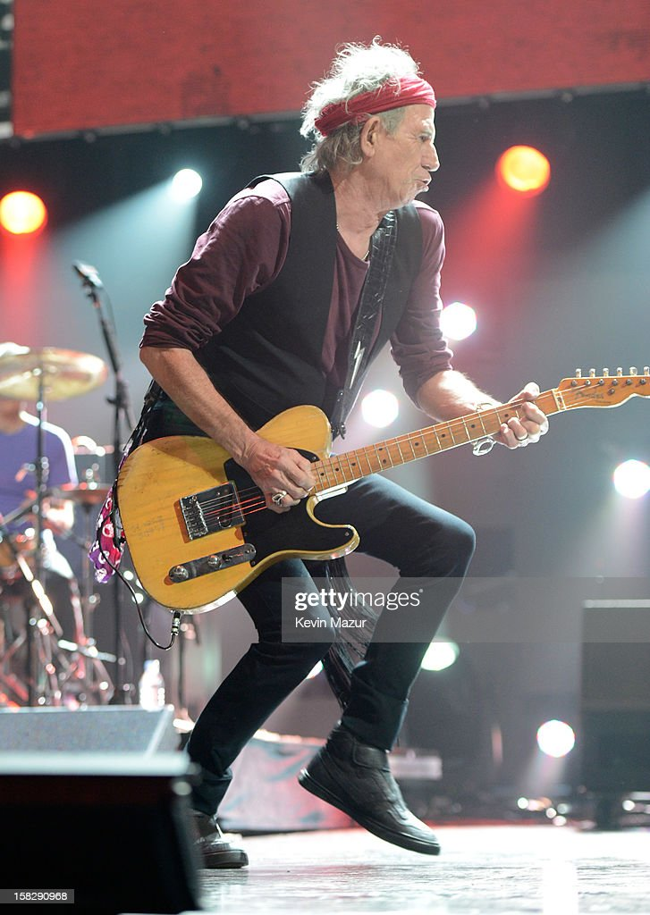 Keith Richards of The Rolling Stones performs at '12-12-12' a concert benefiting The Robin Hood Relief Fund to aid the victims of Hurricane Sandy presented by Clear Channel Media & Entertainment, The Madison Square Garden Company and The Weinstein Company at Madison Square Garden on December 12, 2012 in New York City.