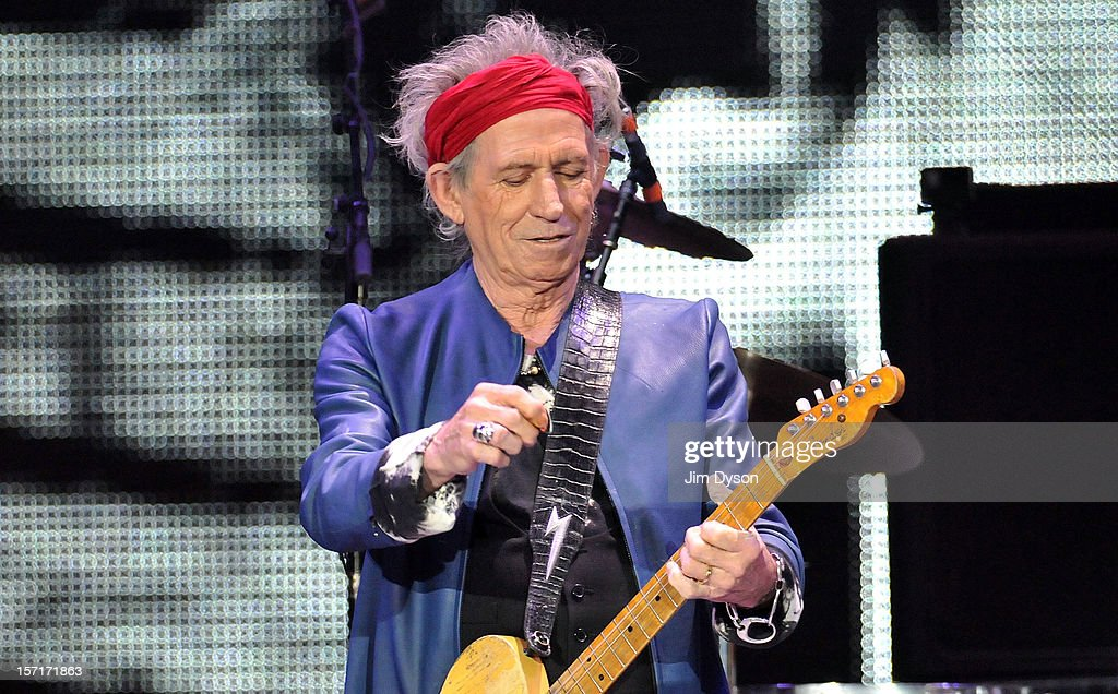 Keith Richards of The Rolling Stones performs live on stage, during their 50th anniversary tour at O2 Arena on November 29, 2012 in London, England.