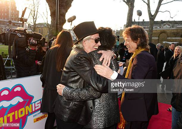 Keith Richards Ronnie Wood and Mick Jagger attend a private view of 'The Rolling Stones Exhibitionism' at The Saatchi Gallery on April 4 2016 in...