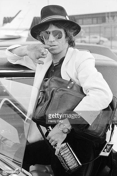 Keith Richards stands at an airport during his 1979 New Barbarians tour