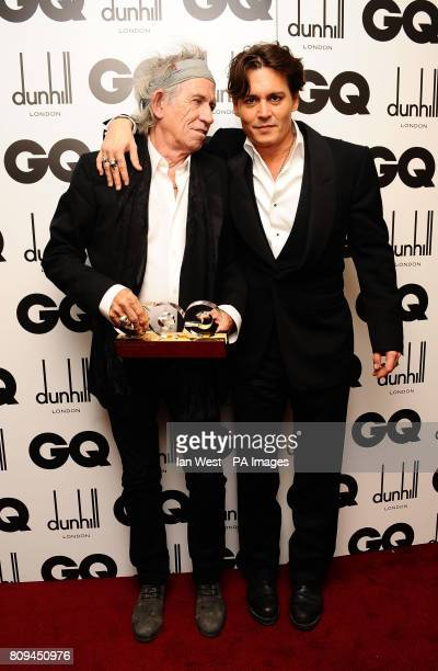 Keith Richards with the Writer of the Year award presented by Johnny Depp at the 2011 GQ Men of the Year Awards at the Royal Opera House Covent...