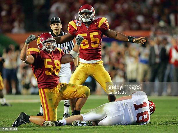 Keith Rivers and Lofa Tatupu of the USC Trojans celebrate after sacking Jason White of the Oklahoma Sooners in the third quarter during the FedEx...