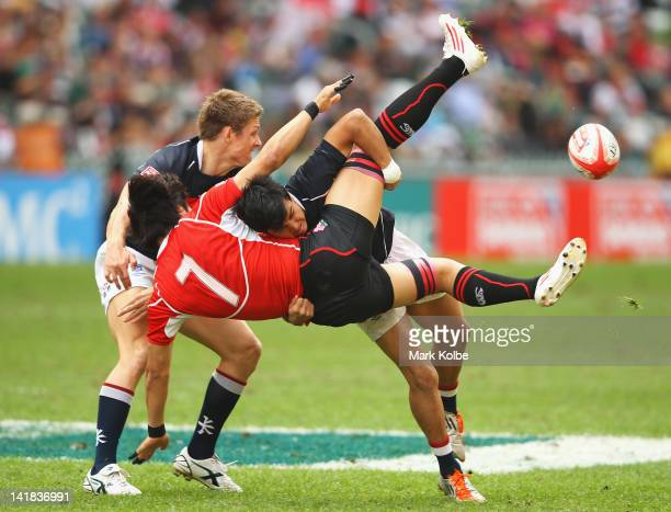 Keith Robertson of Hong Kong tackles Yasutaka Sasakura of Japan during the match between Japan and Hong Kong on day three of the 2012 IRB Hong Kong...