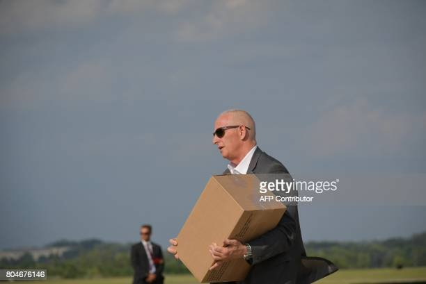 Keith SchillerDirector of Oval Office Operations steps off off Air Force One carrying a box upon arrival in Morristown New Jersey on June 30 2017...