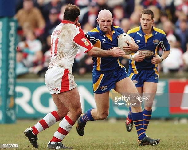 Keith Senior of Leeds is challenged by Chris Joynt of StHelens during the Powergen Challenge Cup Fifth Round match between St Helens and Leeds Rhinos...