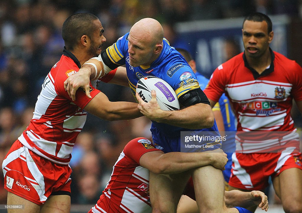 Keith Senior of Leeds is tackled by Thomas Leuluai of Wigan during the Carnegie Challenge Cup Quarter Final match between Leeds Rhinos and Wigan Warriors at Headingley Stadium on May 29, 2010 in Leeds, England.