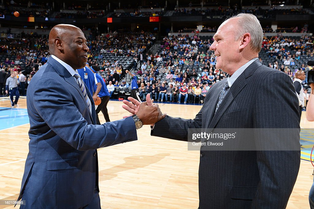 Keith Smart of the Sacramento Kings and George Karl of the Denver Nuggets greet each other before the game on January 26, 2013 at the Pepsi Center in Denver, Colorado.