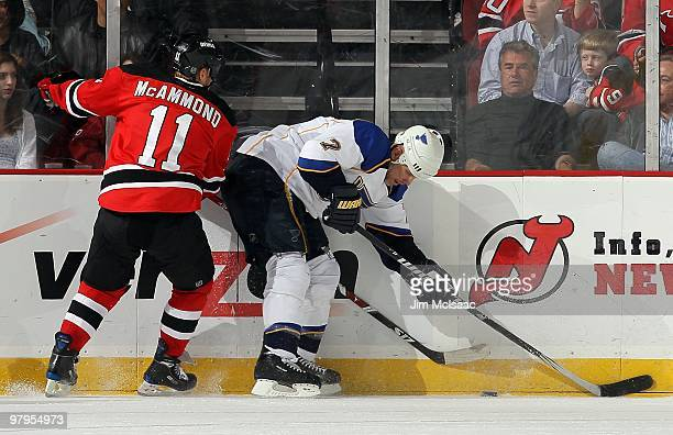 Keith Tkachuk of the St Louis Blues skates against Dean McAmmond of the New Jersey Devils at the Prudential Center on March 20 2010 in Newark New...