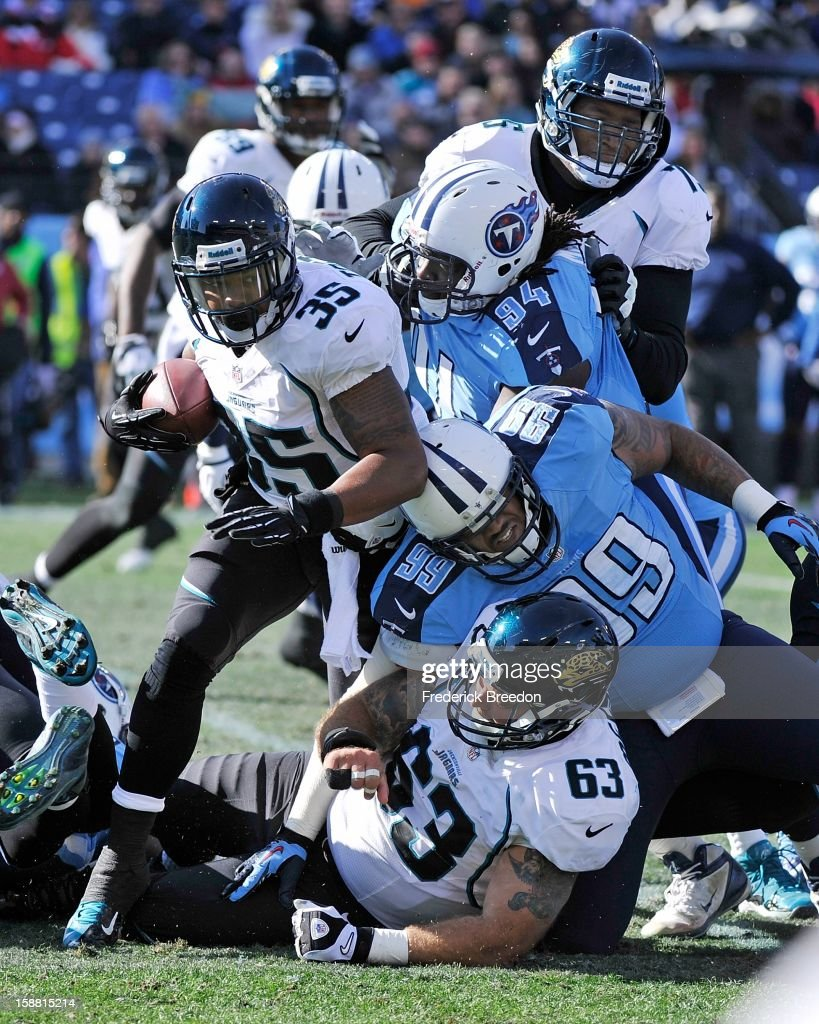 <a gi-track='captionPersonalityLinkClicked' href=/galleries/search?phrase=Keith+Toston&family=editorial&specificpeople=4061941 ng-click='$event.stopPropagation()'>Keith Toston</a> #35 of the Jacksonville Jaguars rushes against the Tennessee Titans at LP Field on December 30, 2012 in Nashville, Tennessee.